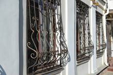 Metal Wrought-iron Bars On  Windows Of Apartment House