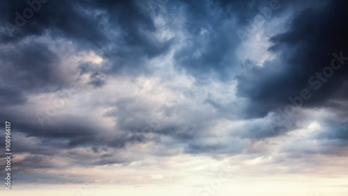 Foto op Canvas Hemel Colorful dramatic sky with dark clouds