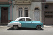 A classic american car in the streets of Old Havana on a sunny day