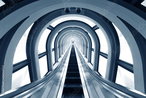 Papiers peints Tunnel Futuristic tunnel and escalator of steel and metal, interior view