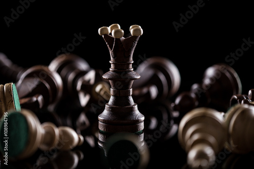 Chess pieces on dark background Wallpaper Mural