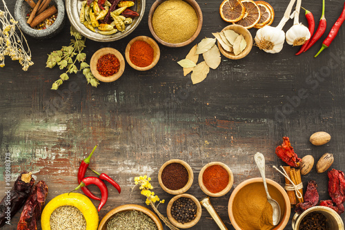 Various spices on vintage board