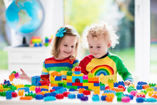Kids Playing With Colorful Pla...