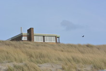 Lonely House In The Dunes Near...