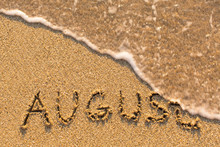 August - Word Drawn On The San...