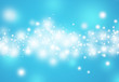 Blue glitter sparkles defocused rays lights bokeh abstract christmas background.