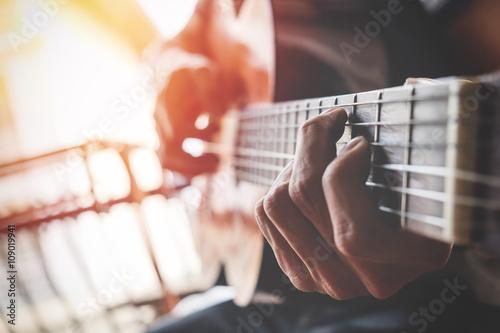 boys hand with a guitar Canvas Print
