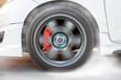 Show burning tires racing in racetracks.