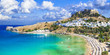 panoramic view of  Lindos bay, village and Acropolis, Rhodes, Gr