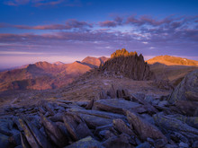 Dawn Over Castell Y Gwynt On Top Of Glyder Fach, With The Snowdon Summits In The Background, Beautiful Morning Light, Wales/ Cymru.