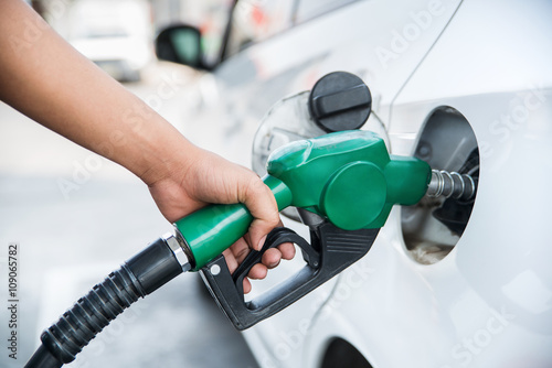 Fotografie, Obraz  Handle fuel nozzle to refuel the car.