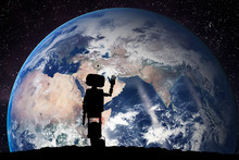 Robot Looking On The Planet Earth From Space. Technology Concept, Artificial Intelligence