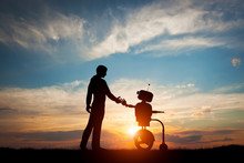 Man And Robot Meet And Handsha...
