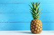 canvas print picture - Ripe pineapple on a white wooden table