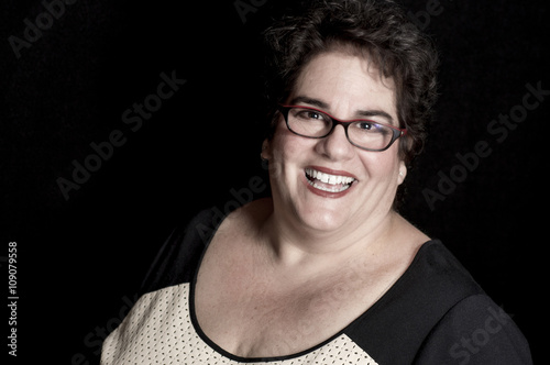 Beautiful Heavy Set Middle-Aged Woman wearing Glasses in Studio Canvas Print