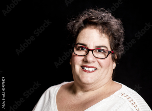 Photo  Beautiful Heavy Set Middle-Aged Woman wearing Glasses in Studio