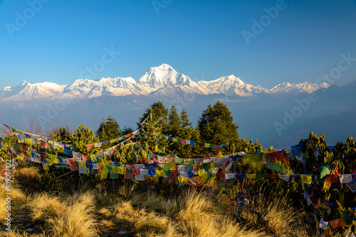Annapurna summit with view from Poonhill, tibetan praying flags in the front, Ne Canvas Print