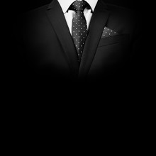 Man In Suit On A Black Backgro...