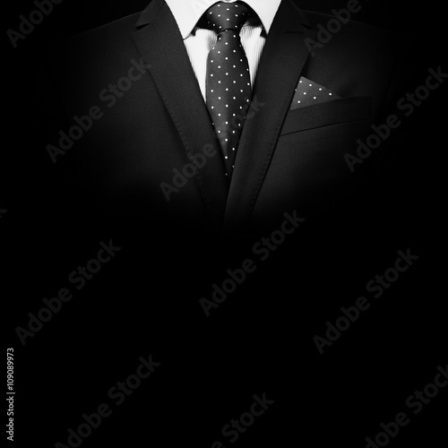 Fotomural man in suit on a black background