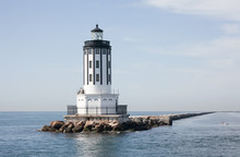 Lighthouse At The Port Of Los Angeles CA Surrounded By Rocks In The Ocean