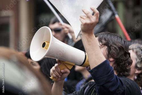 demostrator with megaphone and notebook protesting Tapéta, Fotótapéta