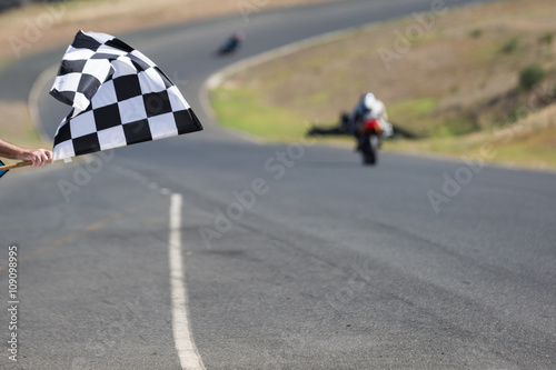 Checkered flag at a motorcycle race track