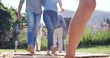 Extended family walking in the garden