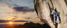Young Male Rock Climber Climbing Challenging Route On Rocky Wall Against Scenic Sunset Background. Summer Time. Climbing Equipment. Panoramic Image