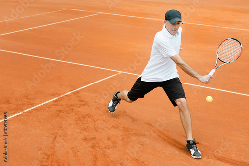 Tennis player in action Tableau sur Toile