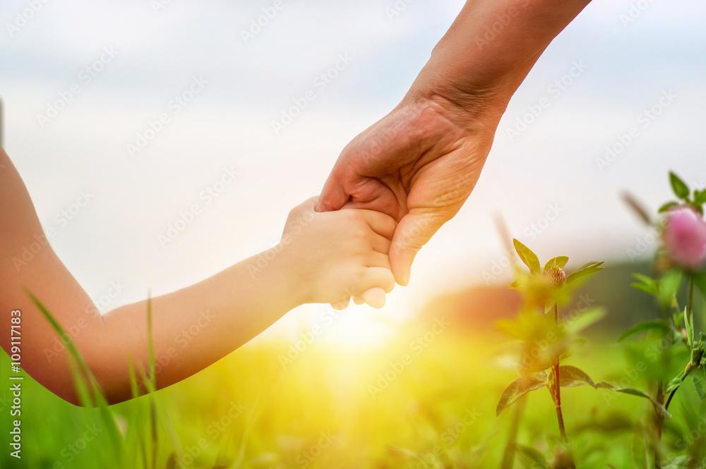 Fototapeta Hands of mother and daughter
