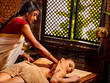 Young woman having Ayurveda spa treatment massage. Healthy spa exotic massage.