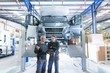 Workers on motorhome production line