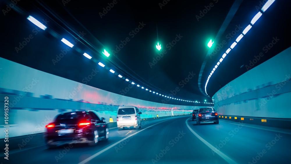 Fototapeta car driving through tunnel