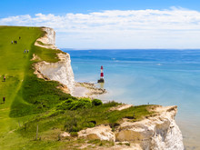 White Chalk Cliffs And Beachy Head Lighthouse, Eastbourne, East Sussex, England