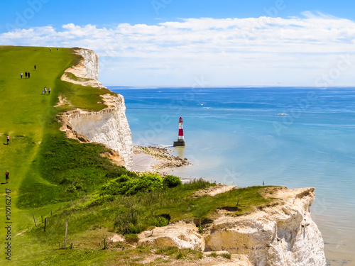 Fotografía  White chalk cliffs and Beachy Head Lighthouse, Eastbourne, East Sussex, England