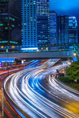 In de dag Tunnel light trails in the downtown district,hongkong china.
