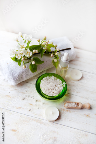 Printed kitchen splashbacks Dairy products Spa composition with flowers sea salt Massage oil and towel on table