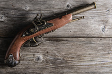 Old Pistol  On The Wooden Board