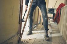 Woker Breaking Door With Crowbar
