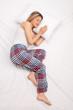 Woman sleeping on a comfortable mattress