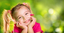 Little Girl Thinking With Daisy In Spring Green