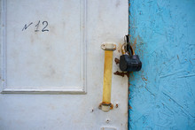 Rusty Padlock On An Old White ...