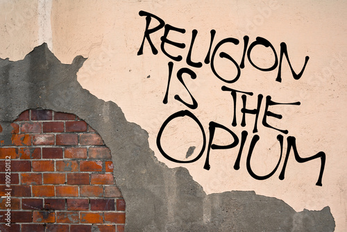 Handwritten graffiti Religion Is The Opium sprayed on the wall, anarchist aesthetics Canvas Print