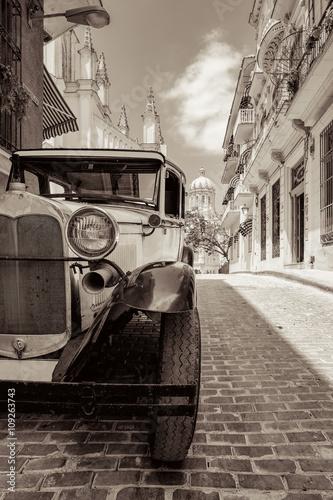 фотография  Antique american car in Havana pictured in sepia