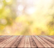Wood table top and autumn bokeh background - used for display your products