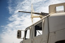 Military Humvee And A Machine Gun