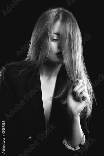 Woman fashion posing in studio in black and white