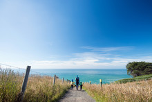 Mother With Two Kids Walking Down The Path To The Beach, New Zealand
