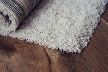 White Carpet On Brown Floor