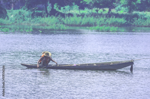 Fotografie, Obraz  A way of life of villager netting for fish on the river in the urban ,  of Thail